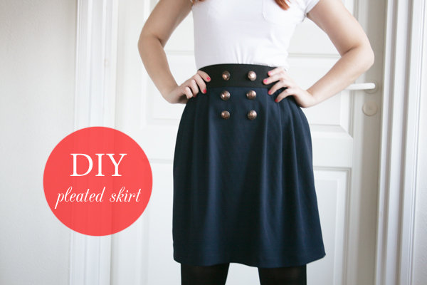 navy pleated skirt with text