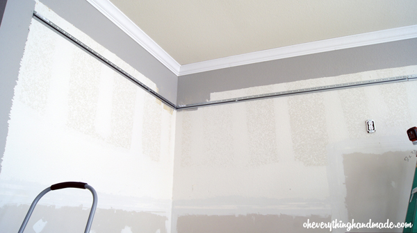 Support the upper cabinets with mounting bars