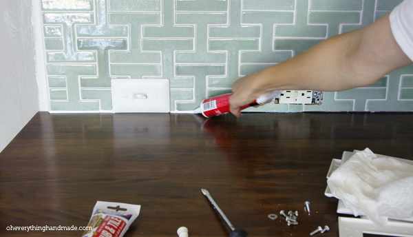 Applying Silicone along the countertops