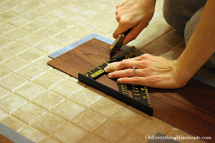 Powder Room Reveal-install allure flooring