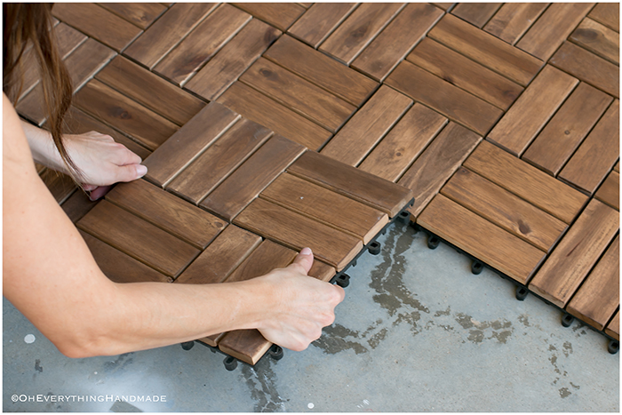 Small balcony makeover - placing the wooden tiles